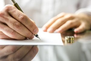 Divorce Process - Man Signing Divorce Papers